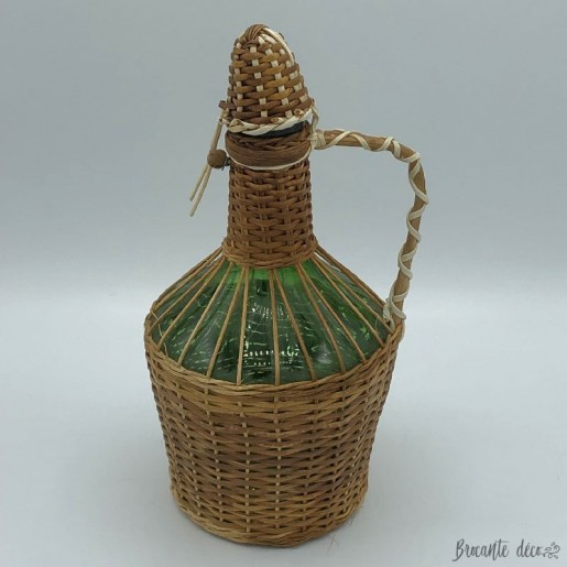 Dame Jeanne vintage bottle covered with wicker