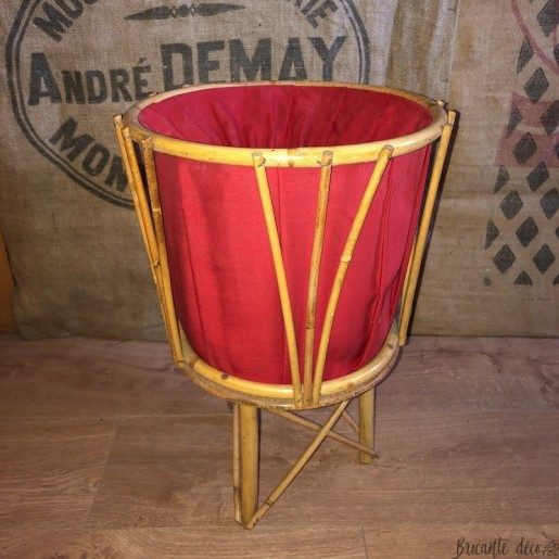 Vintage worker in rattan and red fabric