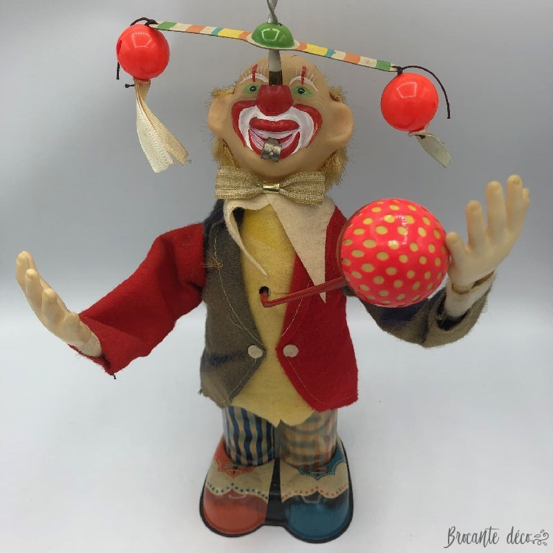Old clown toy in sheet metal
