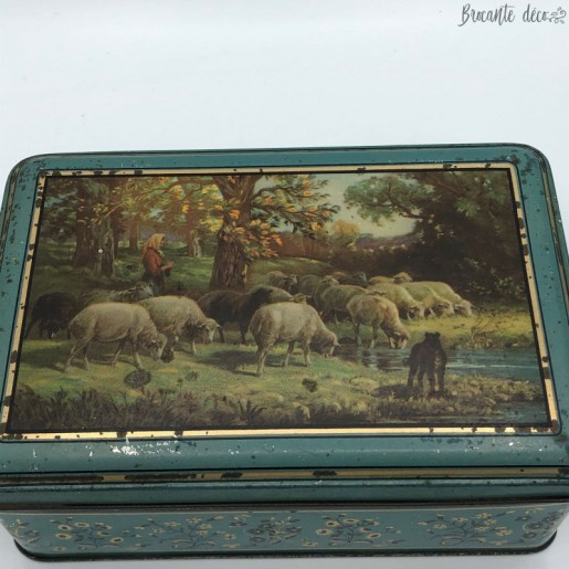 Old lithographed tin box with shepherdess decor and sheep