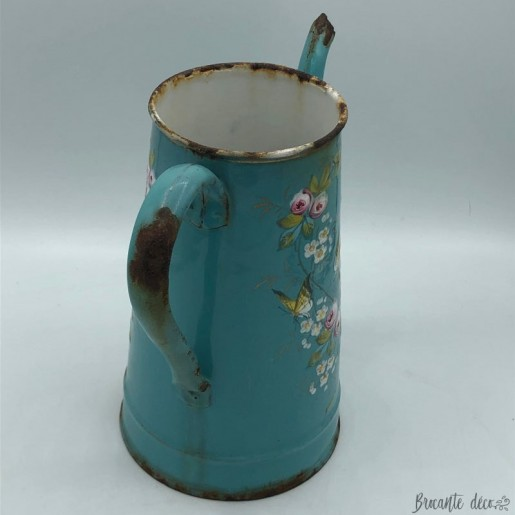 Old enameled coffee pot decorated with birds and butterflies