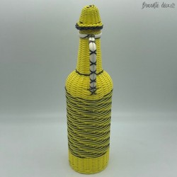 Vintage bottle in yellow and black scoubidou
