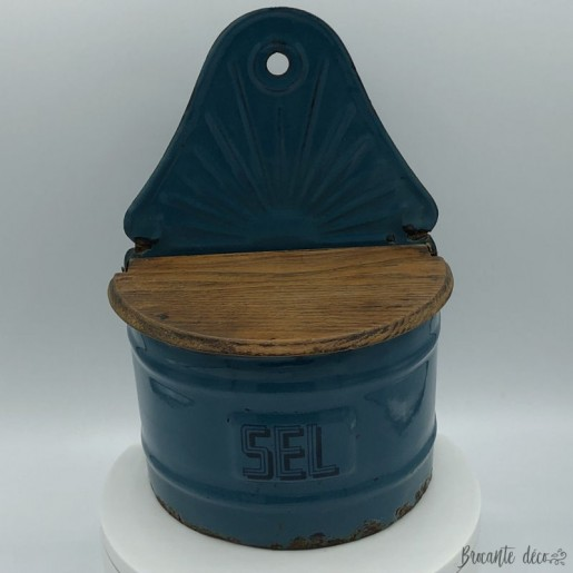 Old salt box in blue enameled sheet with wooden cover