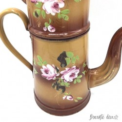 Old and large brown enameled coffeepot with rose decoration