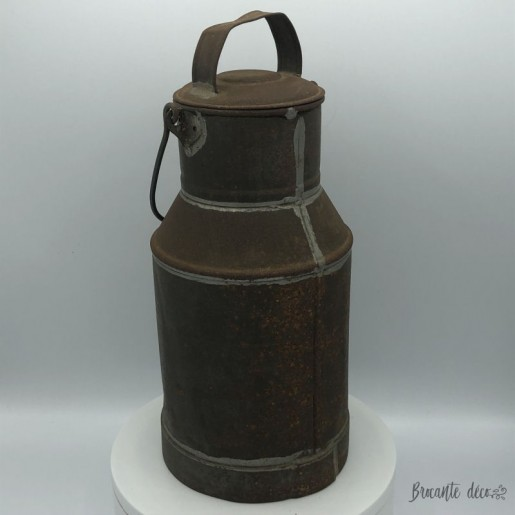 Old iron milk jug | Folk art