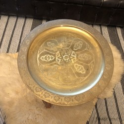 Oriental table with brass top