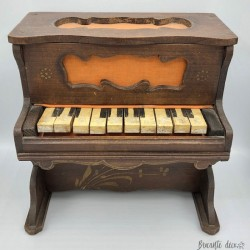 Old wooden toy piano circa 1900