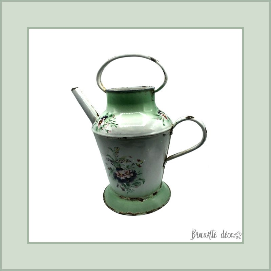 Old jug enameled watering can
