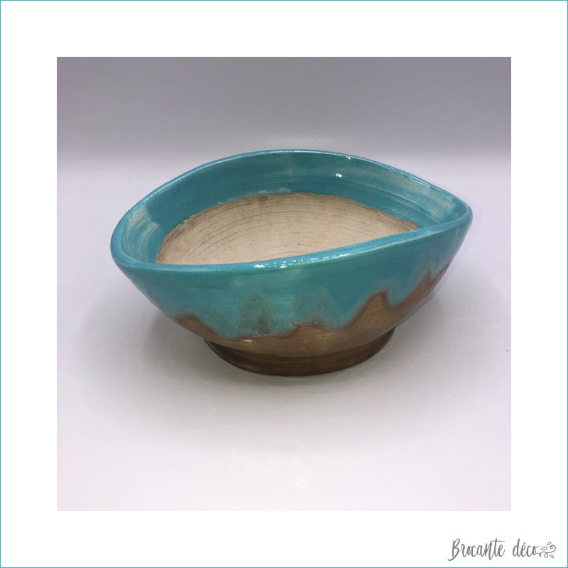 glazed ceramic pot in turquoise blue and light brown color