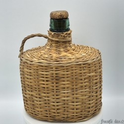 Old bottle covered with wicker | Little Dame Jeanne