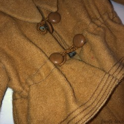 Old set of children's clothes or doll in woolen cloth