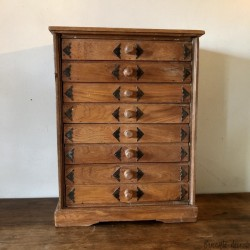Old small wooden storage unit with 8 drawers