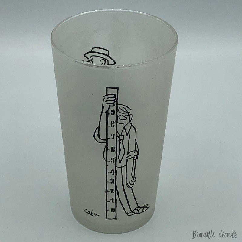 Glass signed by cartoonist...
